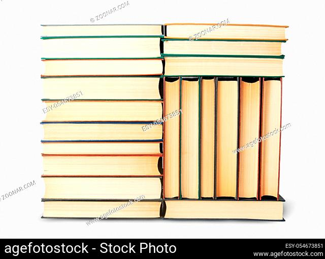 Different stack of old books isolated on white background