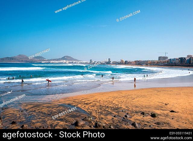 Las Palmas, Spain - March 3, 2019 : Surfers in Las canteras beach, Las Palmas de Gran Canaria Spain