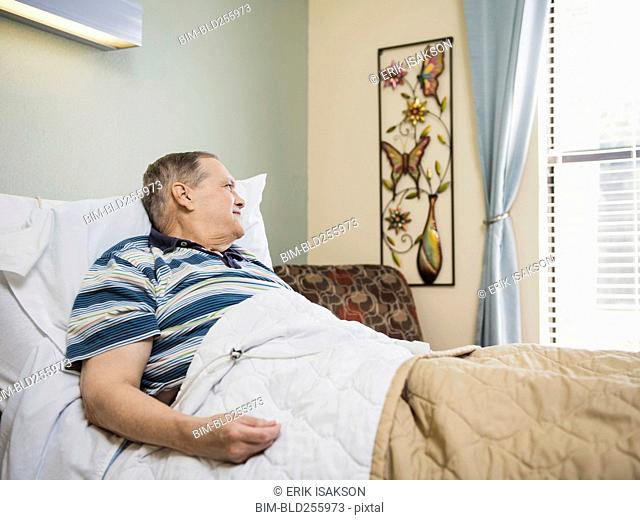 Caucasian man laying in bed