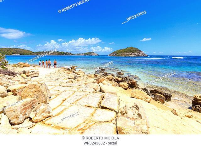 People on rocks overlooking the crystal sea, Half Moon Bay, Antigua and Barbuda, Leeward Islands, West Indies, Caribbean, Central America