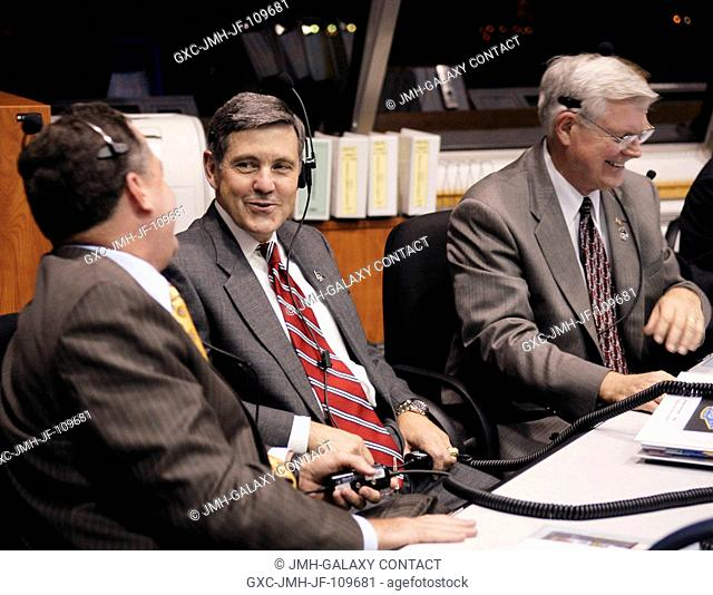 Center Director Bob Cabana (center) shares a happy moment in the Firing Room of the Launch Control Center at NASA's Kennedy Space Center in Florida after the...