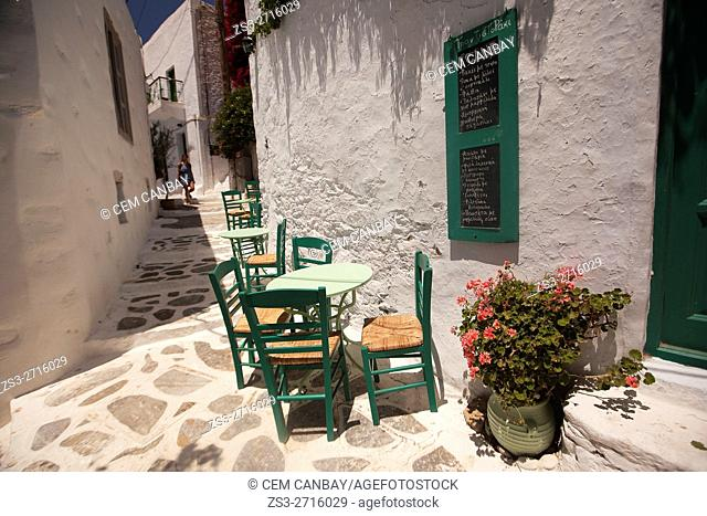 Colorful chairs and tables of a cafe-restaurant in the old town Chora, Amorgos, Cyclades Islands, Greek Islands, Greece, Europe
