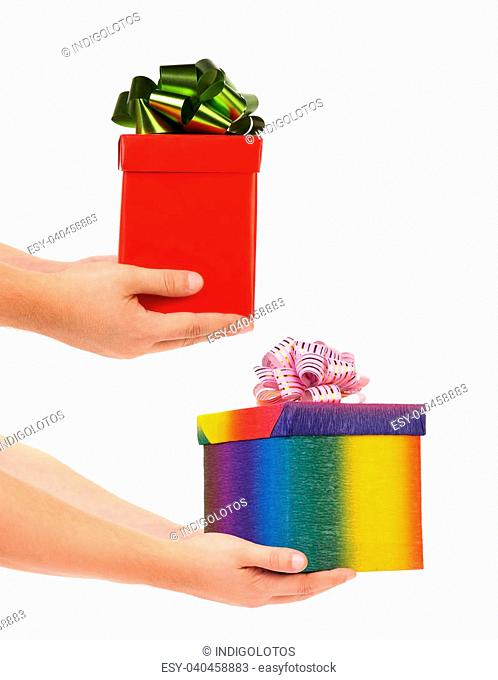 Two hands giving presents. Isolated on a white background