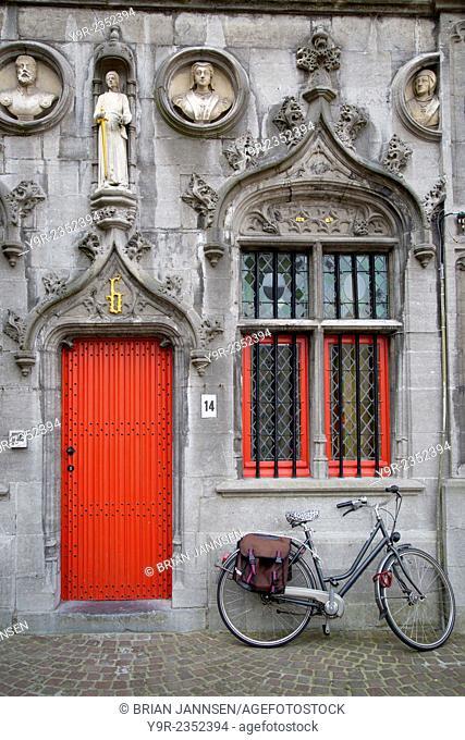 Red Door into the Historic Basiliek van het Heilig Bloed - Basilica of the Holy Blood, Bruges, Belgium