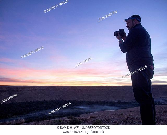 Silhouette of photographer during sunset, Morocco