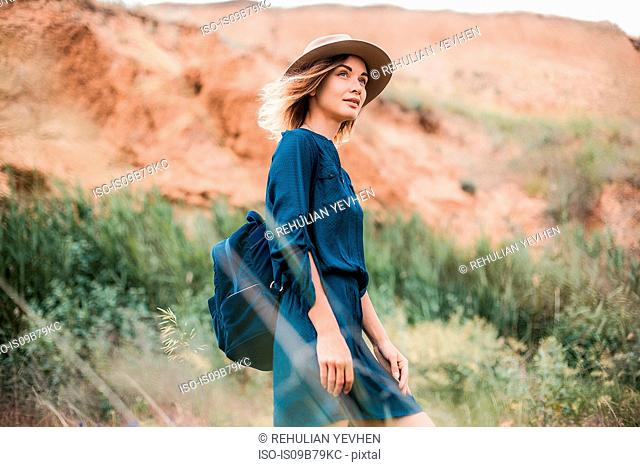 Mid adult woman in rural setting, looking at view