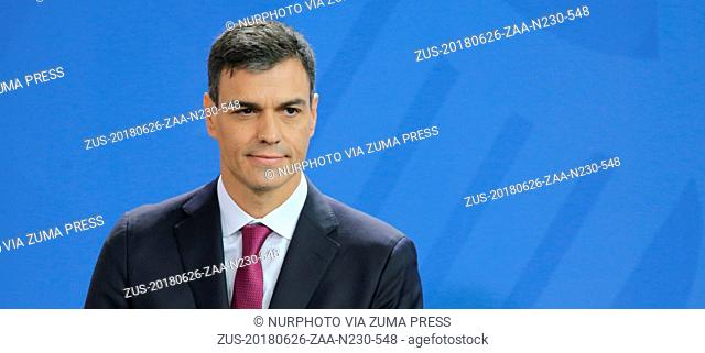 June 26, 2018 - Berlin, Berlin, Germany - Spanish Prime Minister Pedro Sanchez reacts while speaking to the media with and German Chancellor Angela Merke...