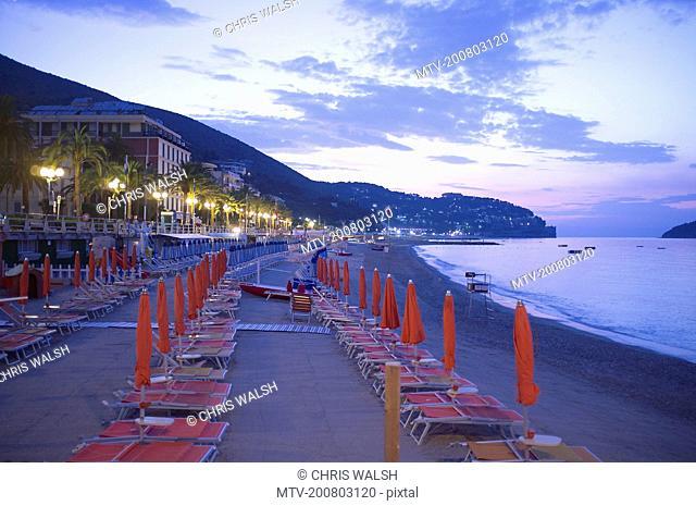 Sunrise Italy beach sunshades hotels deckchairs