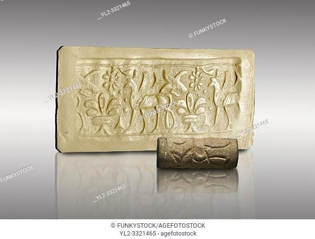 Hittite cylinder seal depicting a scene of animals, seal in foreground and impression standing behind. . Adana Archaeology Museum, Turkey