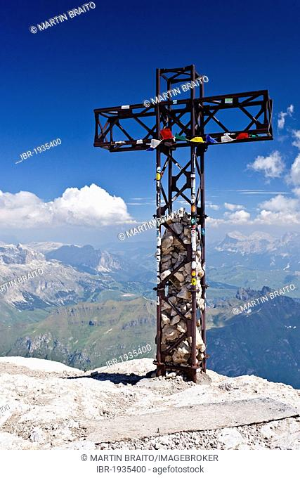 Summit cross of Marmolada mountain, Dolomites, Sella group, Heiligkreuzkofel group and Fedaia pass at the back, province of Trento, Italy, Europe