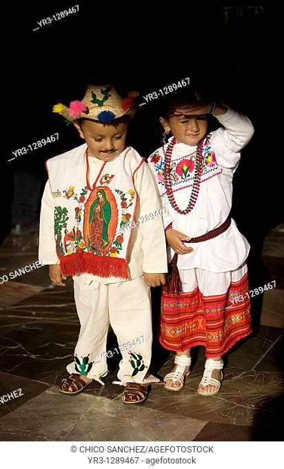 Children dressing traditional indigenous costumes pose in the Our Lady of Guadalupe Basilica in Mexico City, December 8, 2010  Hundreds of thousands of Mexican...