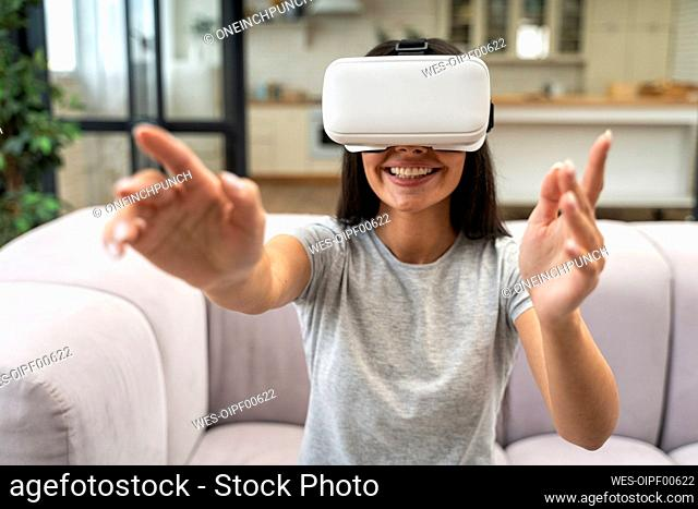 Woman with Virtual reality headset in living room at home