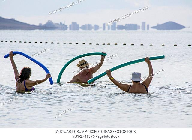 Excercising in the Mar Menor at Los Alcazares Beach in the region of Murcia, Costa Calida, Spain
