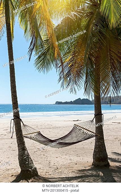 Hammock tied to tree trunk at beach, Samara, Costa Rica