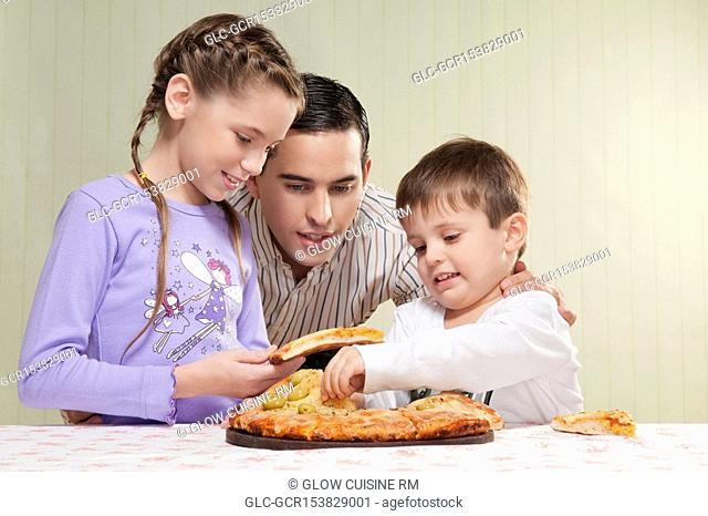 Family sharing a pizza