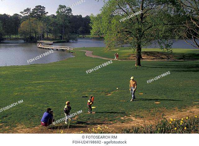 Callaway Gardens, Pine Mountain, Georgia, GA, Family playing baseball next to Mountain Creek Lake at Callaway Gardens in Pine Mountain