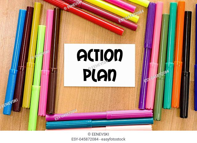 Action plan written on memo over wooden background