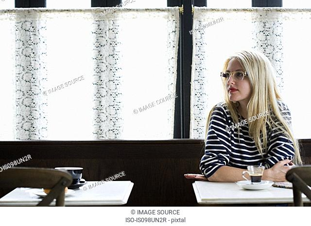 Woman waiting in coffee shop