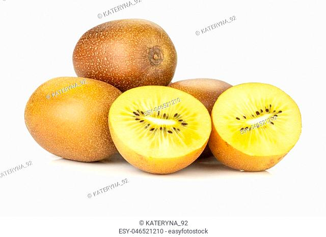 Group of lot of whole two halves of fresh golden brown kiwi fruit sungold variety heap isolated on white