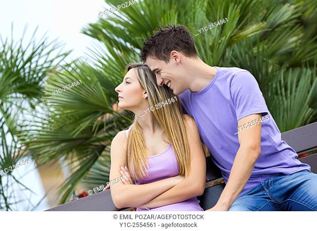 Teen couple girl and boy acting indifference
