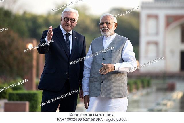 24 March 2018, India, New Delhi: German President Frank-Walter Steinmeier ..(L) Indian Prime Minister Narendra Modi taking a stroll in the Sunder Nursery garden...