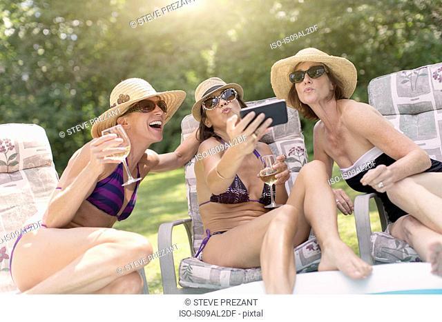 Three mature women taking self portrait using smartphone