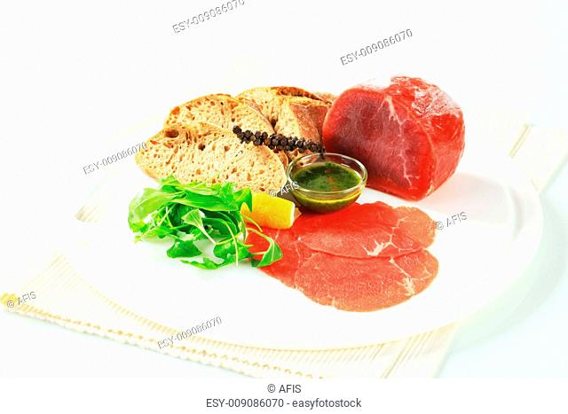 Ingredients to make a dish of beef Carpaccio