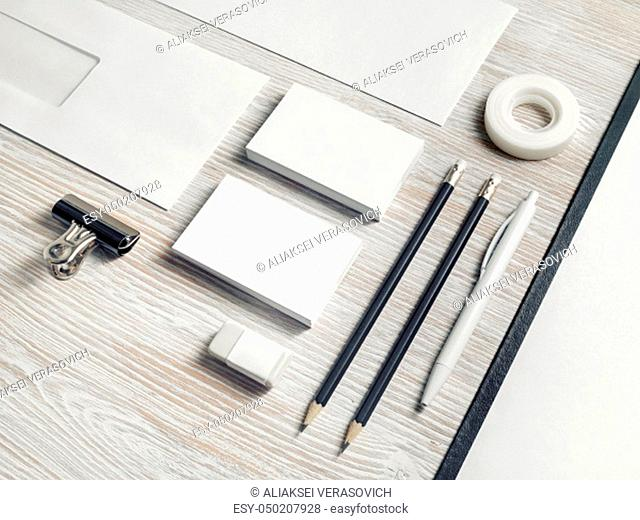 Blank corporate identity. Stationery template on light wood table background. Branding mockup