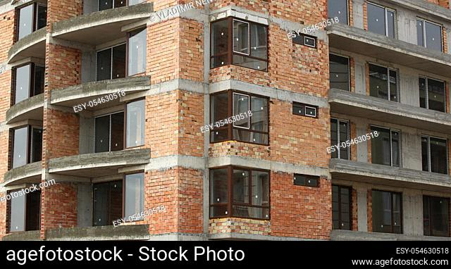 Newly built building in a residential complex. New construction site