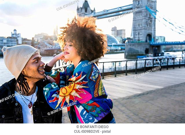 Portrait of young couple outdoors, face to face, Tower Bridge in background, London, England, UK