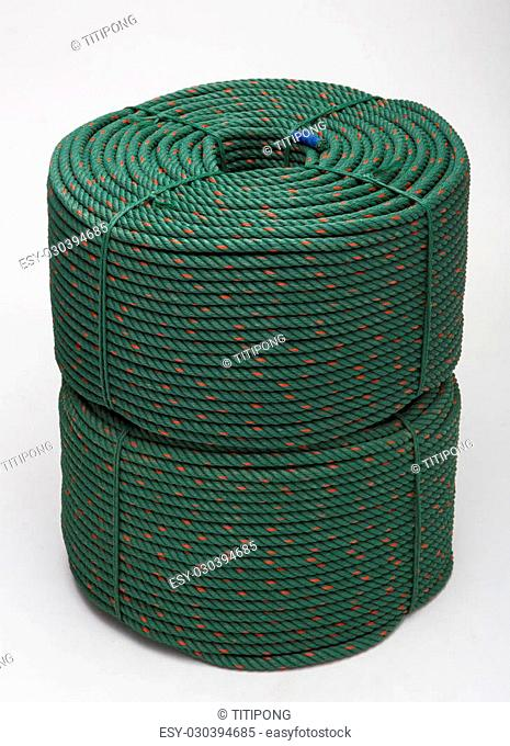 large roll with new green rope for the shipping industry