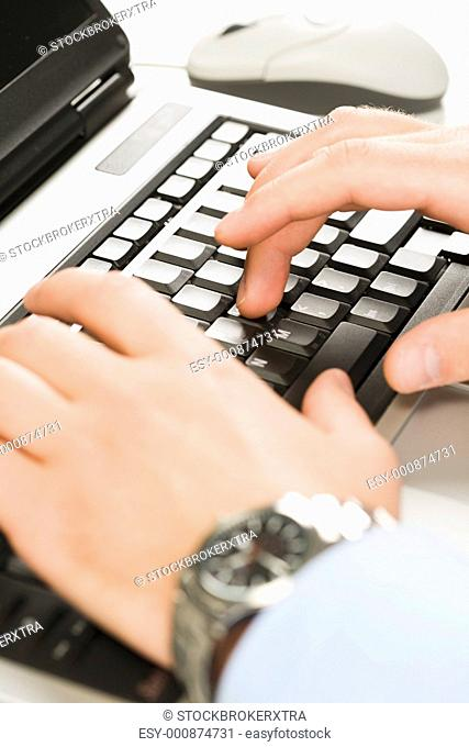 Human hands typing on the laptop