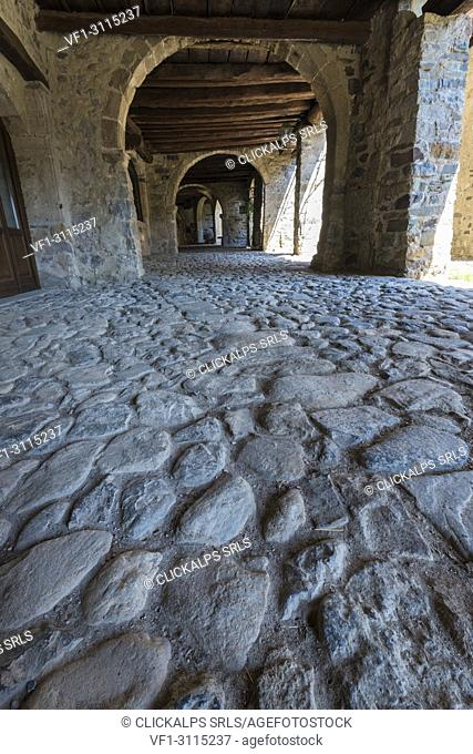The ancient arcade of the market in Cornello dei Tasso, along Via Mercantorum, Val Brembana, Province of Bergamo, Orobie alps, Italian alps, Italy