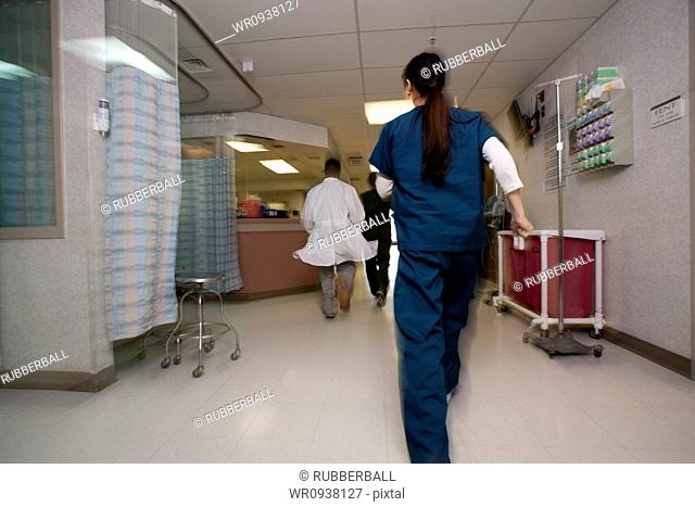 Doctor and nurses rushing through corridor