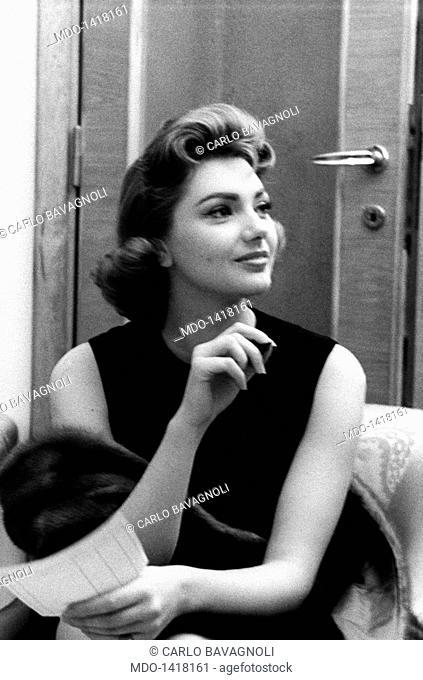 Sylva Koscina seated with a mink tippett. Sylva Koscina, an actress of Yugoslav origin, in a three quarter pose with a mink tippett