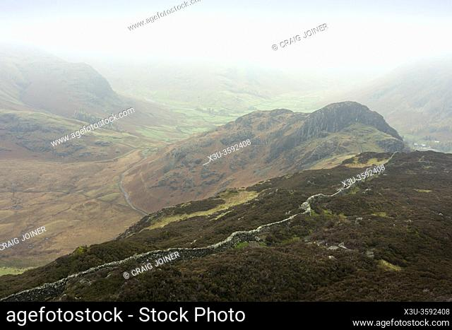 Side Pike from Lingmoor Fell with Bow Fell in the mist beyond in the Lake District National Park, Cumbria, England
