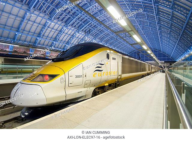 Eurostar train in St Pancras Station at dusk, London, England