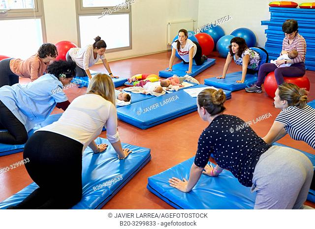 Matron, Mothers with babies in postpartum gymnastics, Health Center, Zarautz, Gipuzkoa, Basque Country, Spain