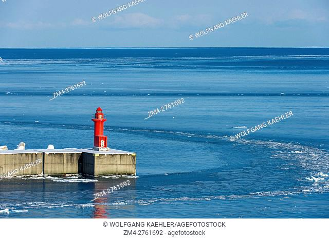 View of a lighthouse at the harbor in Utoro in the Sea of Okhotsk in winter, Abashiri Shiretoko National Park (UNESCO World Heritage Site)
