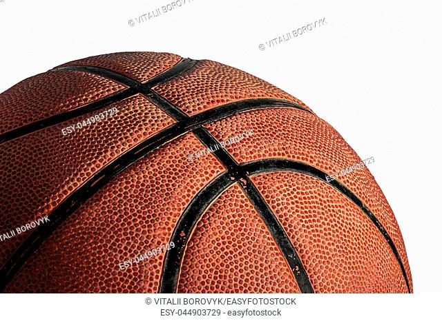 Part of basketball ball illuminated from above. Isolated on white background. Side view