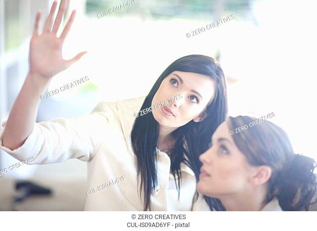 Interior designer advising client at her home