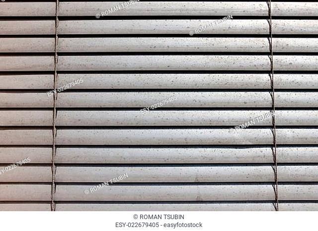 grey shutters over a shop window