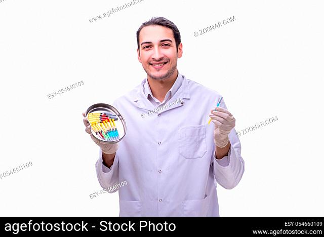 The young handsome doctor with syringe isolated on white