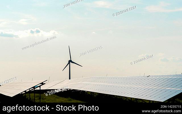 The wind turbine and the solar field at a sunny day