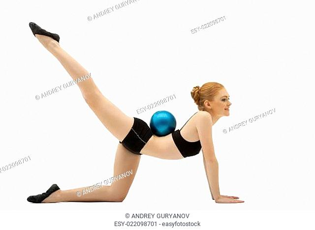 girl in black training cloth with gymnastic ball