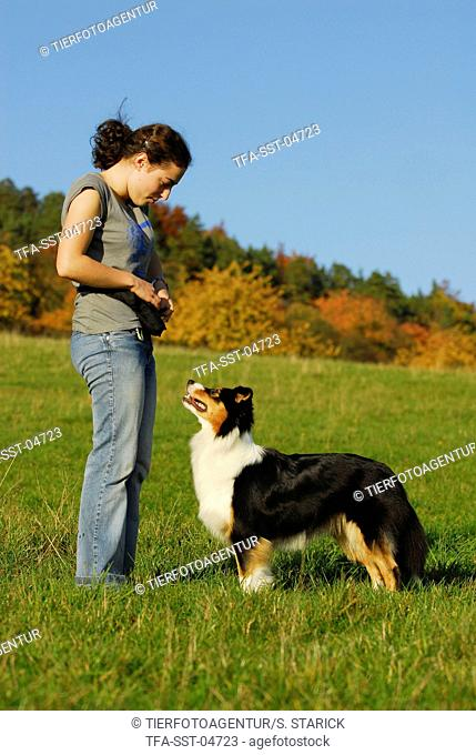 young woman with Australian Shepherd