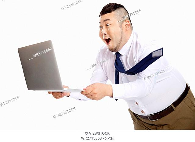 Business fat man using a computer