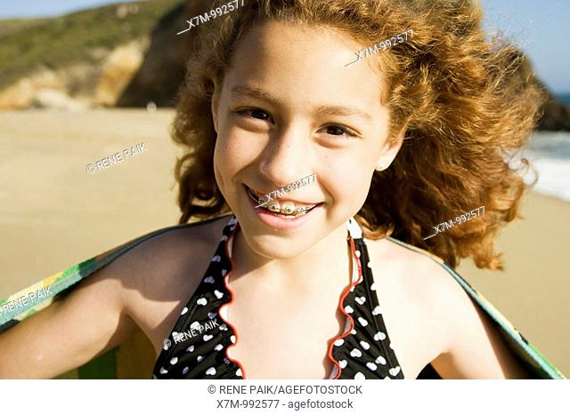 Happy young mixed race Mexican & caucasian girl at a beach in Santa Cruz, California
