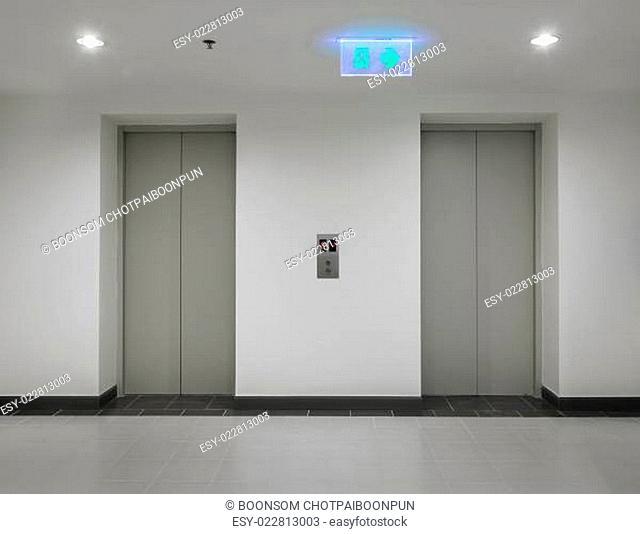 Two elevators with closed door