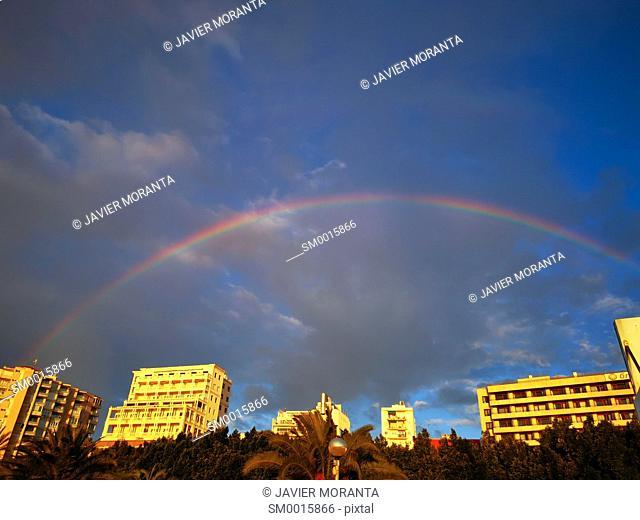 Rainbow over buildings on the promenade of Palma de Mallorca, Balearic Islands, Spain